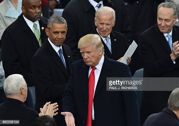 US President Donald Trumpis appluaded by former President Barack Obama former Vice President Joe Biden and Sen Chuck Schumer DNY during Trump's...