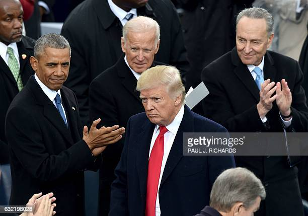 US President Donald Trumpis appluaded by former President Barack Obamaa former Vice President Joe Biden and Sen Chuck Schumer DNY during Trump's...