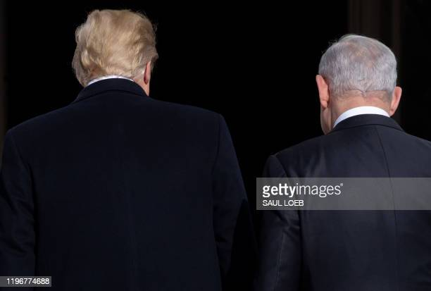 President Donald Trump(L0 greets Israeli Prime Minister Benjamin Netanyahu as he arrives for meeting on the South Lawn of the White House in...