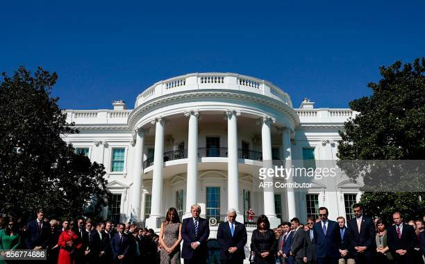 US President Donald Trumpm First Lady Melania Trump US Vice President Mike Pence and his wife Karen participate in a moment of silence on the South...
