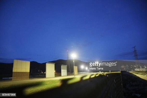 S President Donald Trump's border wall prototypes as seen from the Mexico side of the US/ Mexico border on March 8 2018 in Tijuana Mexico President...