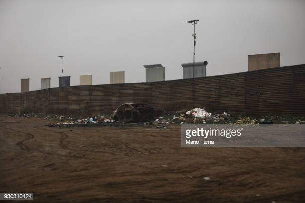 S President Donald Trump's border wall prototypes stand above the current border fence as seen from the Mexico side of the US/ Mexico border on March...