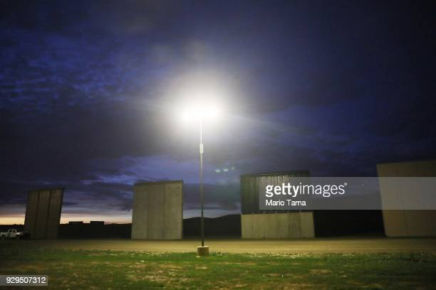 S President Donald Trump's border wall prototypes stand as seen from the Mexico side of the US/ Mexico border on March 8 2018 in Tijuana Mexico...