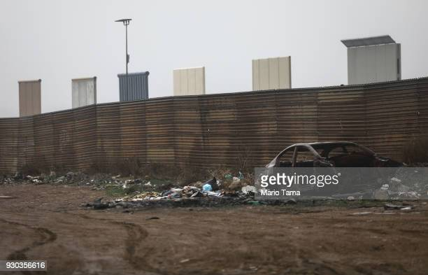 S President Donald Trump's border wall prototypes stand as seen from the Mexico side of the US/ Mexico border on March 10 2018 in Tijuana Mexico...