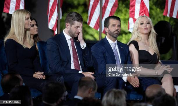 President Donald Trump's children, Ivanka Trump, Eric Trump, Donald Trump Jr. And Tiffany Trump, sit on the stage as their father delivers his...