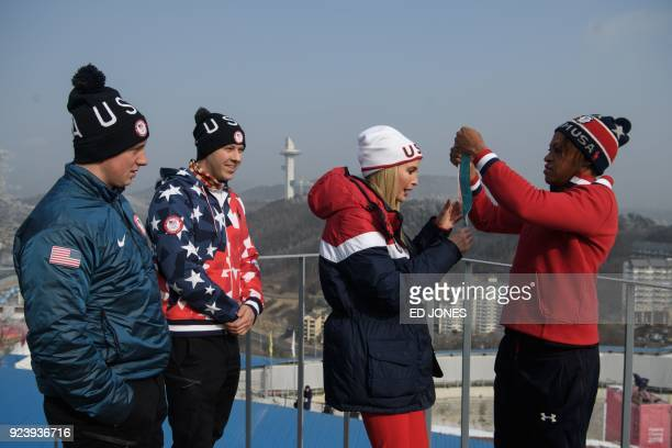 US President Donald Trump's daughter and senior White House adviser Ivanka Trump poses for a photo on a balcony of the VIP tent at the Olympic...