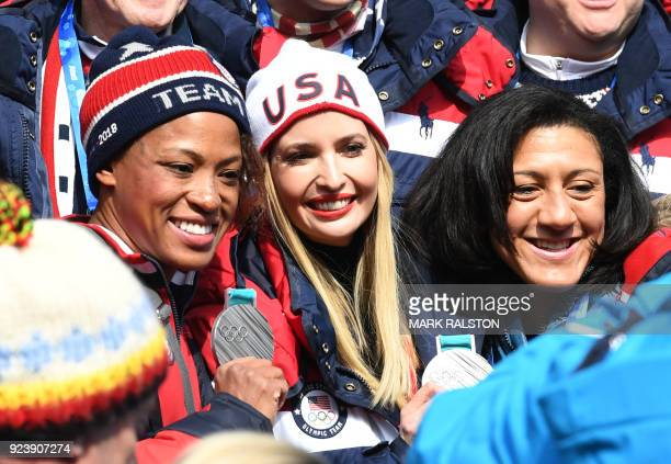 US President Donald Trump's daughter and senior White House adviser Ivanka Trump poses with women's bobsleigh silver medallists Lauren Gibbs and...