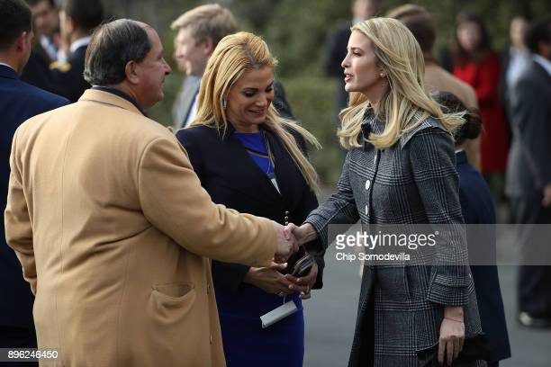 S President Donald Trump's daughter Ivanka Trump greets guests during an event to celebrate Congress passing the Tax Cuts and Jobs Act with...