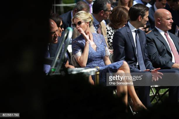 President Donald Trump's daughter Ivanka Trump whispers to Deputy National Security Advisor Dina Powell while they and Senior Advisor to the...