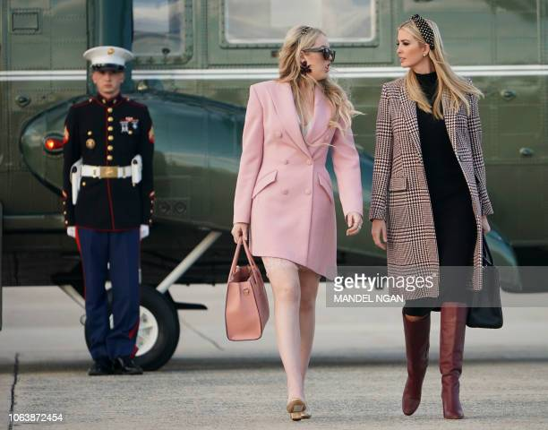 US President Donald Trump's daughters Tiffany Trump and Ivanka Trump make their way to board Air Force One before departing from Andrews Air Force...