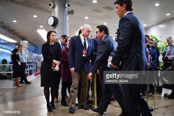 US President Donald Trump's defense team member Jay Sekulow and White House Principal Deputy Press Secretary Hogan Gidley turn away after Sekulow...