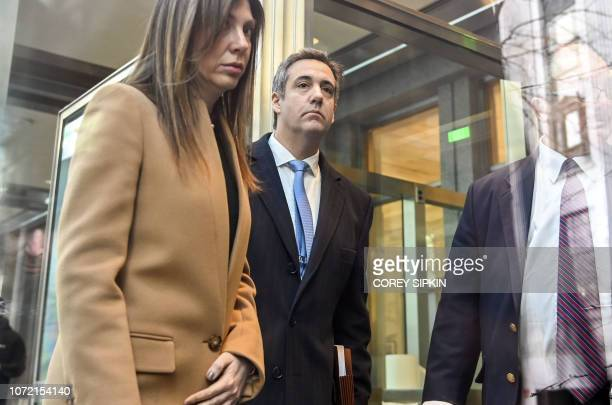 US President Donald Trumps former attorney Michael Cohen arrives with wife Laura Shusterman at US Federal Court in New York on December 12 where he...