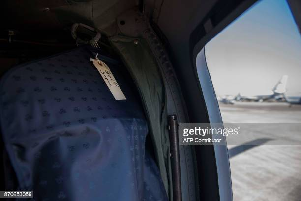 US President Donald Trump's garment bag for his golf clothes hangs in a Black Hawk helicopter at Yokota Airbase in Tokyo Japan on November 5 2017 /...