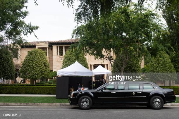 US President Donald Trump's limousine is seen outside a home in Beverly Hills California on April 5 as he attends a fundraiser US President Donald...
