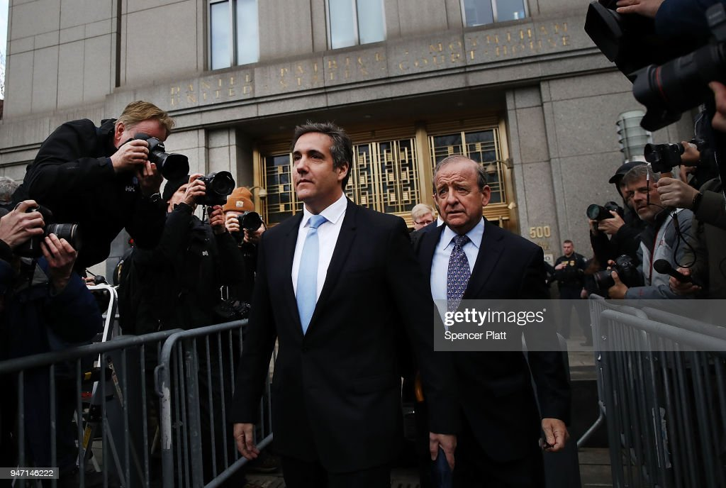 President Donald Trump's long-time personal attorney Michael Cohen (left) exits a New York court on April 16, 2018 in New York City. Trump's lawyers on Sunday night asked a federal judge to temporarily block prosecutors from reviewing files seized by the FBI from Cohen's offices and hotel room last week. Trump's lawyers have argued that many of the documents are protected by attorney-client privilege.