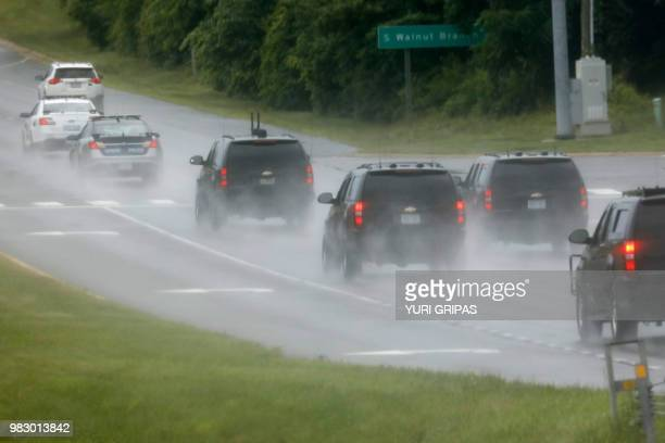 President Donald Trump's motorcade drives back to the White House from Trump National Golf Club in Sterling, Virginia on June 24, 2018.