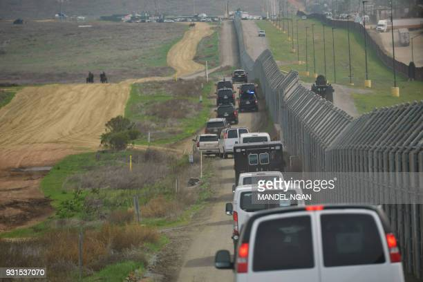 US President Donald Trump's motorcade makes its way along the border where he inspected border wall prototypes in San Diego California on March 13...