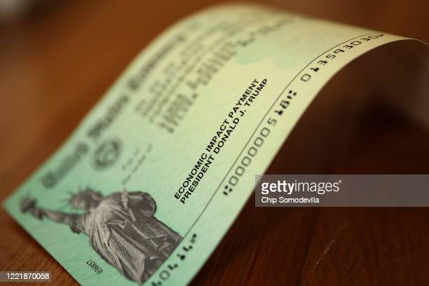 President Donald Trump's name appears on the coronavirus economic assistance checks that were sent to citizens across the country April 29, 2020 in...