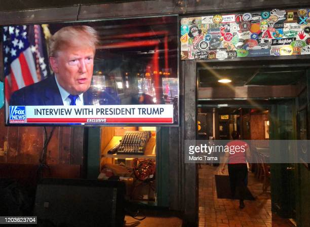 President Donald Trump's pre-game Super Bowl interview with Fox News is broadcast in a bar on February 2, 2020 in Washington, DC. Closing arguments...