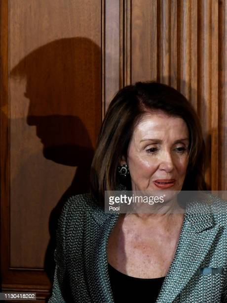 US President Donald Trump's shadow is seen behind House Speaker Nancy Pelosi during the Friends of Ireland Luncheon in honor of Ireland Prime...
