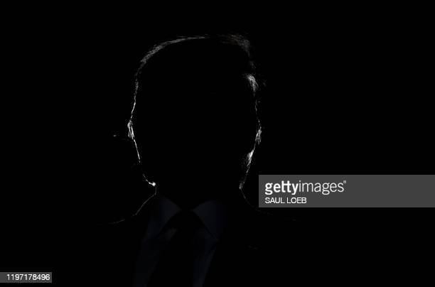 "President Donald Trump's silhouette is seen during a ""Keep America Great"" campaign rally at Wildwoods Convention Center in Wildwood, New Jersey,..."