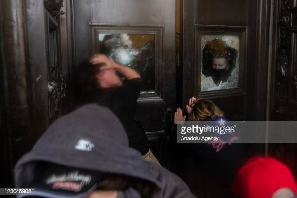 President Donald Trumps supporters, who breached security and attept to enter the Capitol building, are experiencing pepper spray in Washington D.C.,...