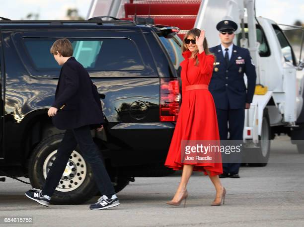 President Donald Trump's wife Melania Trump and their son Barron Trump walk to their vehicle after arriving together on Air Force One at the Palm...