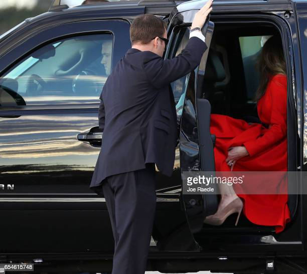 President Donald Trump's wife Melania Trump enters a vehicle after arriving on Air Force One at the Palm Beach International Airport to spend part of...