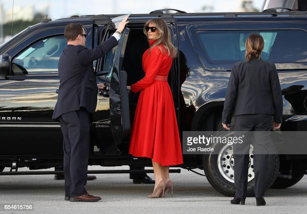 President Donald Trump's wife Melania Trump prepares to get into a vehicle after arriving on Air Force One at the Palm Beach International Airport to...