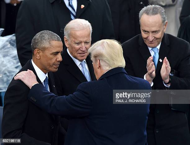 US President Donald Trumpspeaks with former President Barack Obama as former Vice President Joe Biden and New York Sen Chuck Schumer look on during...