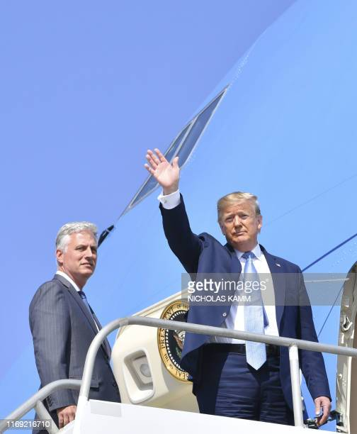 US President Donald Trumpwaves next to new national security advisor Robert O'Brien on September 18 2019 at Los Angeles International Airport in Los...