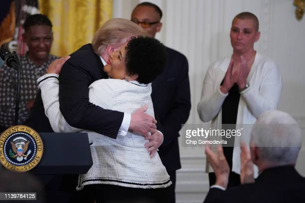 S President Donald Turmp embraces Alice Marie Johnson during a celebration of the First Step Act in the East Room of the White House April 01 2019 in...