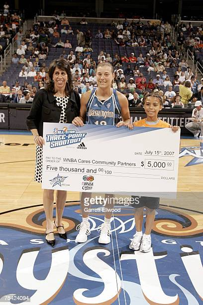 President Donna Orender and the 3 Point Shootout winner Laurie Koehn of the Washington Mystics pose prior to the 2007 WNBA AllStar Game presented by...