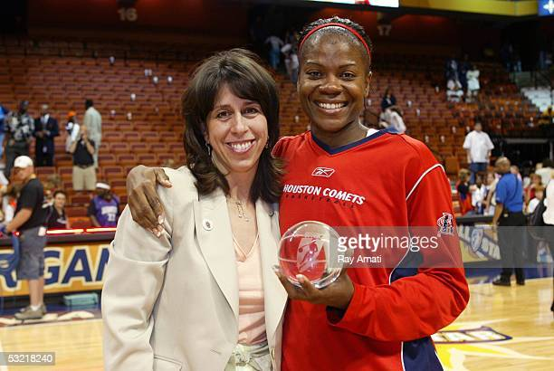 President Donna Orender poses with AllStar MVP Sheryl Swoopes after playing in the 2005 WNBA AllStar Game on July 9 2005 at the Mohegan Sun Arena in...