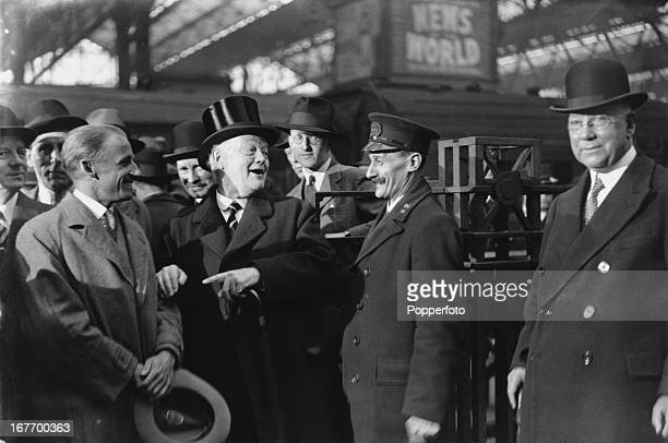 MCC President Douglas Hogg 1st Viscount Hailsham introduces Australian cricketer Don Bradman to a ticket collector as the Australian cricket team are...
