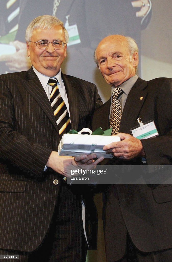 President Dr. Theo Zwanziger gives a birthdaypresent to Dettmar Cramer during the 50th annual football teacher seminar at the german academy of sport on April 27, 2005 in Cologne, Germany.