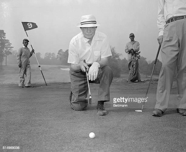 President Dwight D. Eisenhower enjoys a round of golf.