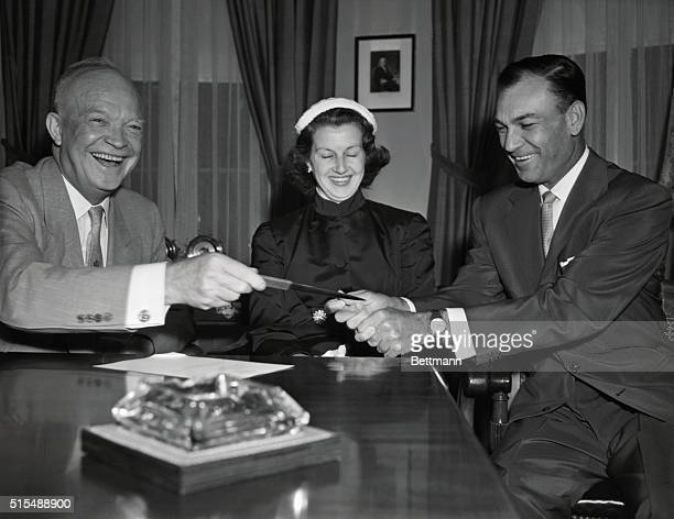 President Dwight D. Eisenhower, left, today was visited by U.S. Open Golf champion Ben Hogan, right, and Mrs. Hogan, center, prior to the President's...
