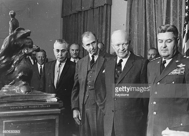 President Dwight D Eisenhower presenting the Robert J Collier Trophy to Dr Louis G Dunn and Frank Pace Jnr for developing the ATLAS the first...