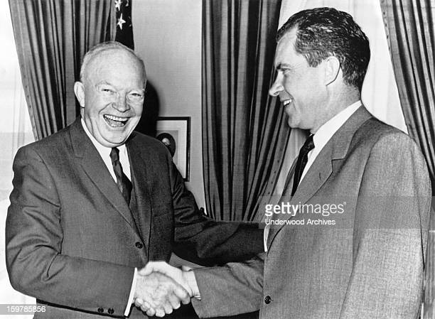 President Dwight D Eisenhower shakes hands with Vice President Richard Nixon after a conference at the White House Washington DC October 3 1960 Nixon...