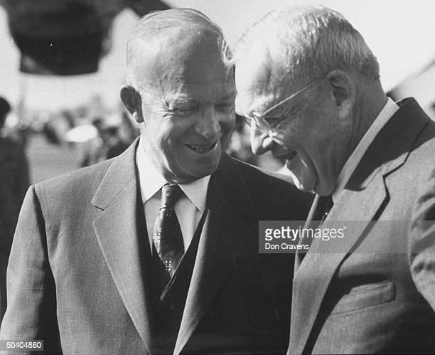 President Dwight D. Eisenhower speaking w. John Foster Dulles at National aiport.