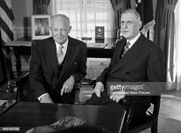 US President Dwight D Eisenhower talks with French President Charles de Gaulle in the White House's Oval Office Washington DC April 25 1960