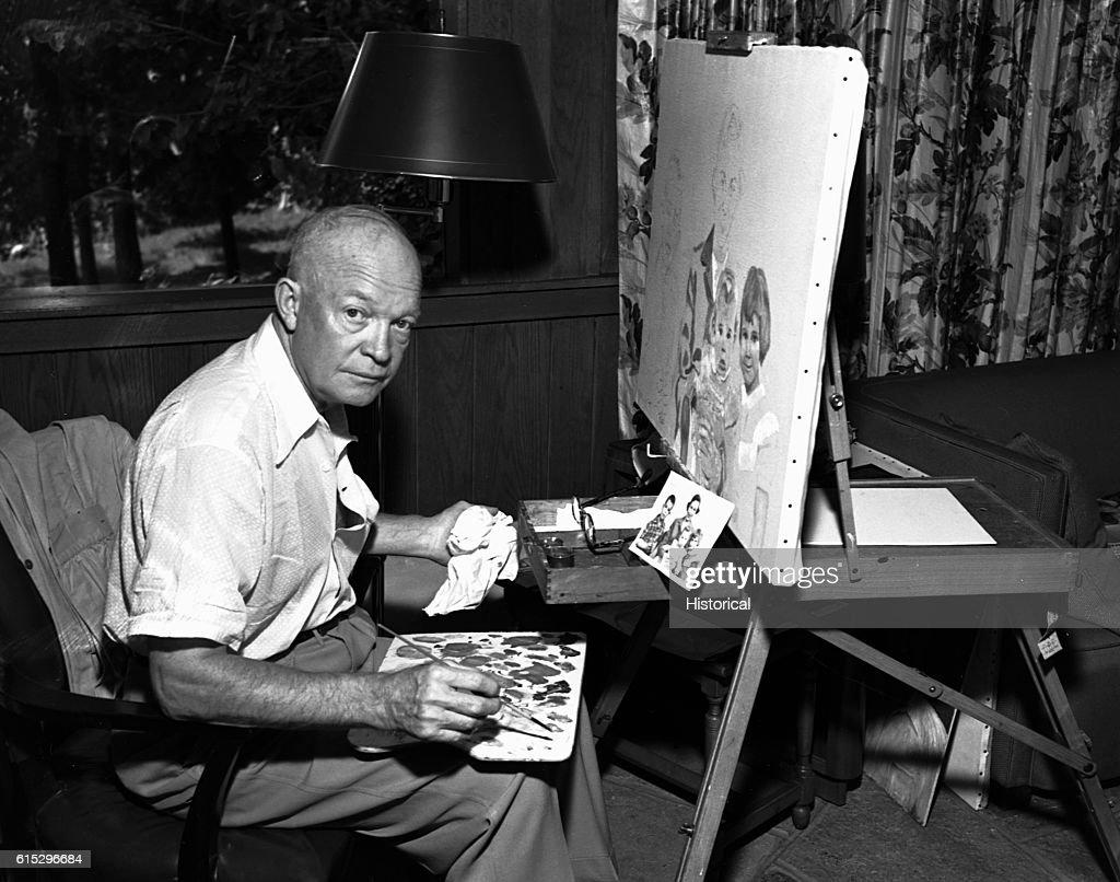 President Eisenhower Painting at Camp David : News Photo