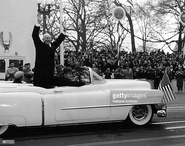 President Dwight D. Eisenhower waves to the crowd during his Inauguration parade January 20, 1953 in Washington D.C.