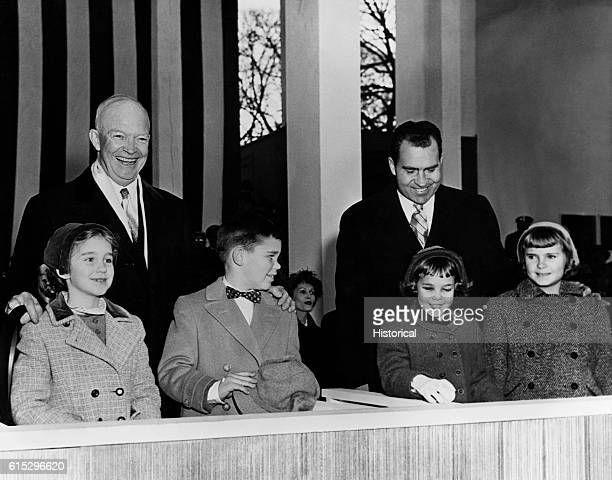 President Dwight Eisenhower and Vice President Richard Nixon greet the public on their second Inauguration Day, Eisenhower with his grandchildren...