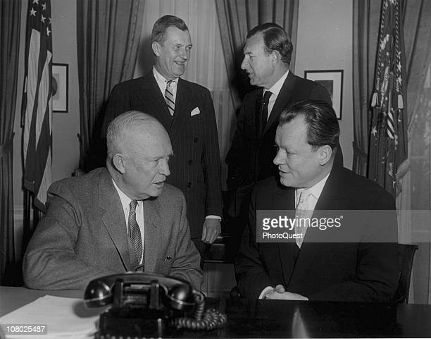 US President Dwight Eisenhower confers with German politician and Mayor of West Berlin Willi Brandt at the White House Washington DC February 11 1959