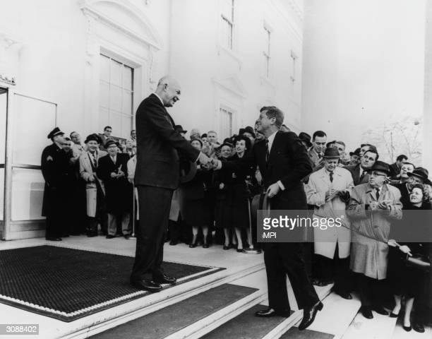 President Dwight Eisenhower greeting the President-Elect John F Kennedy .