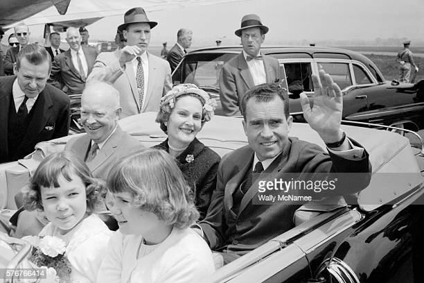 President Dwight Eisenhower rides in the back seat of a limousine convertible with vice president Richard Nixon and Nixon's wife Pat The Nixon...