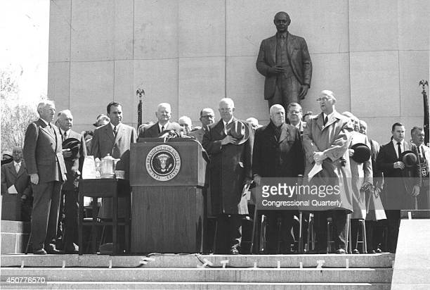 President Dwight Eisenhower right and former President Herbert Hoover left stand behind the podium during the memorial dedication of the Robert A...