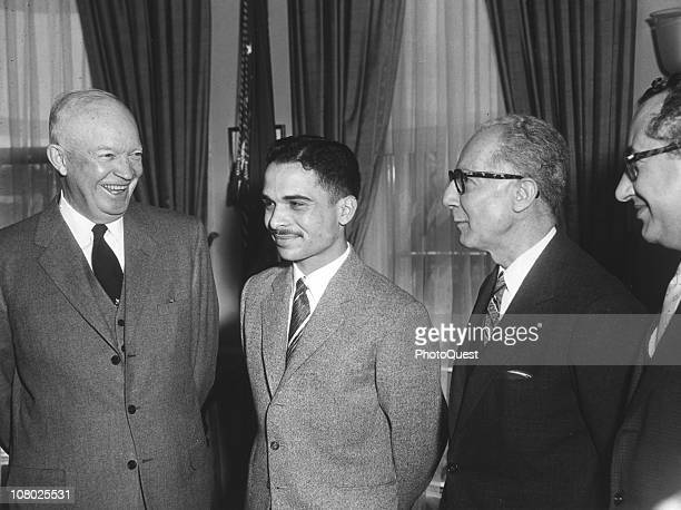 US President Dwight Eisenhower shares a laugh with King Hussein of Jordan and unidentified others in the White House Washington DC March 25 1959